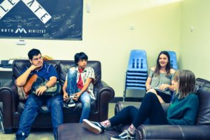 Mission Viejo Church of Christ Youth Group Members in a meeting