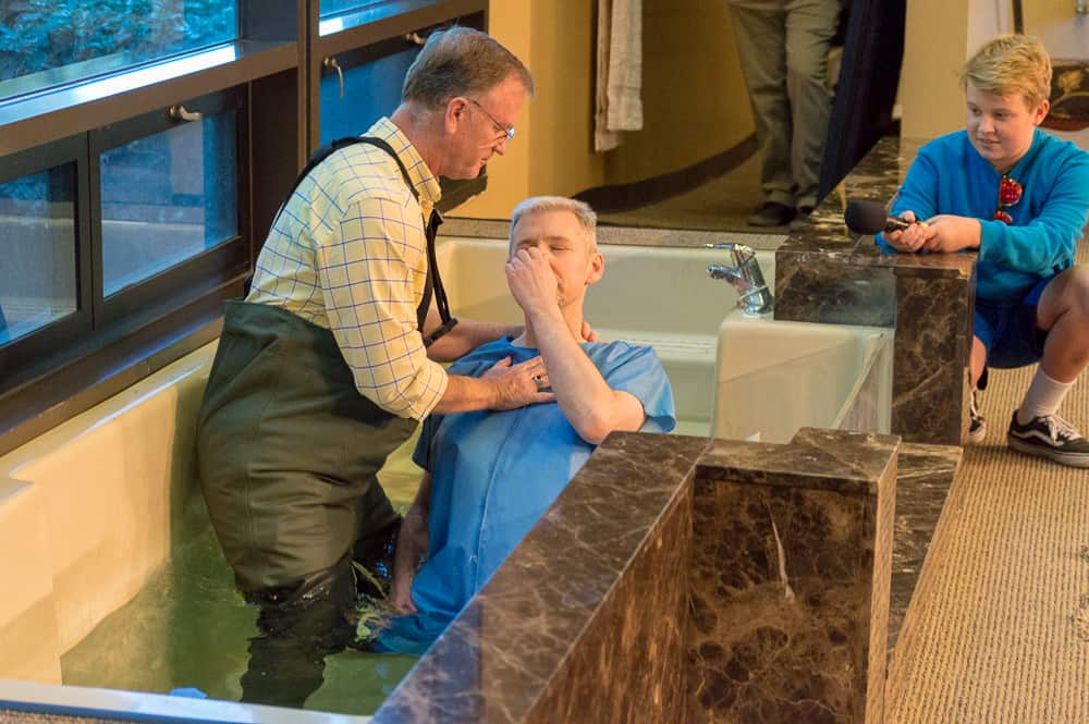 Pastor Ed Bush baptizes brother at Mission Viejo Church of Christ
